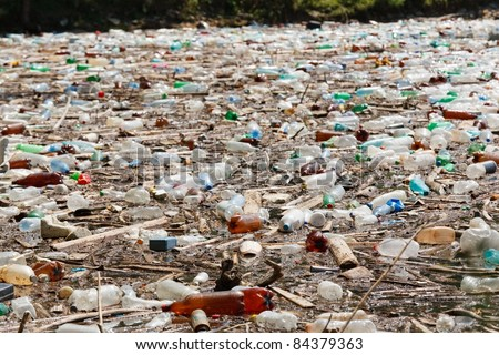 plastic bottles floating on water surface, Bicaz lake, Romania - stock photo