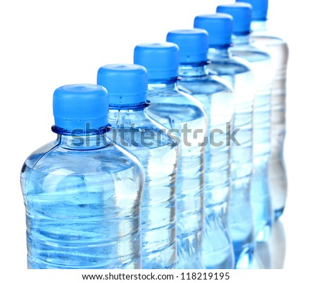 plastic bottles of water isolated on white - stock photo