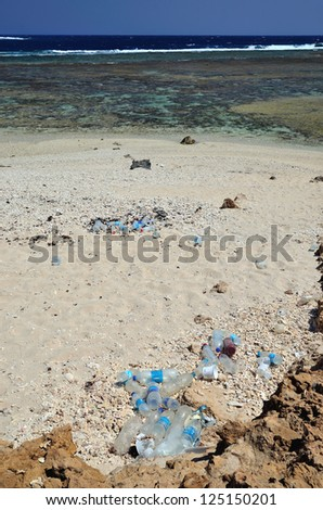 plastic bottles on the beach - stock photo