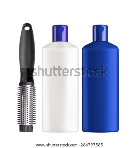 Plastic bottles shampoo and comb isolated on white background - stock photo