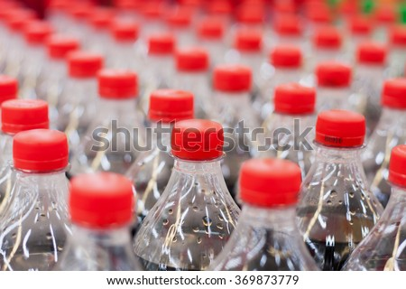 plastic bottles with soft drinks background - stock photo