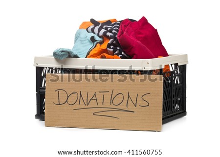 Plastic box with clothing donations and cardboard sign over white background