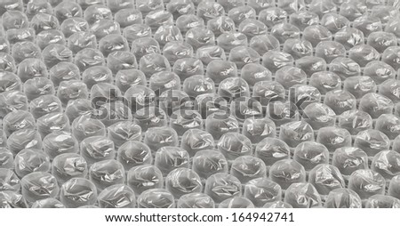 Plastic bubble wrap background often used in packaging fragile items for delivery in the post - stock photo