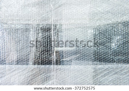 Plastic bubble wrap for packing,background pattern selective focus. - stock photo