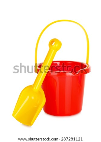 plastic bucket and spade isolated on white