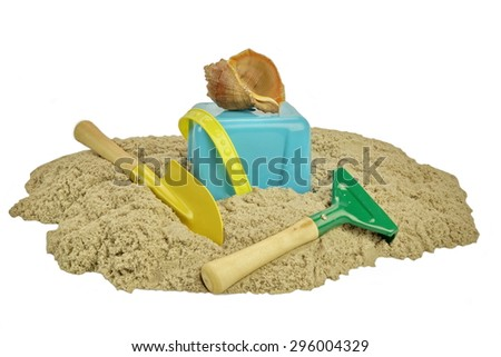 Plastic Bucket With Sand And Beach Toy Isolated On White Background. Childrens Creativity Or Beach Game Concept. - stock photo