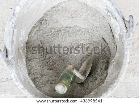 Plastic buckets for transport of cement at construction, cement mixing in plastic bucket  - stock photo