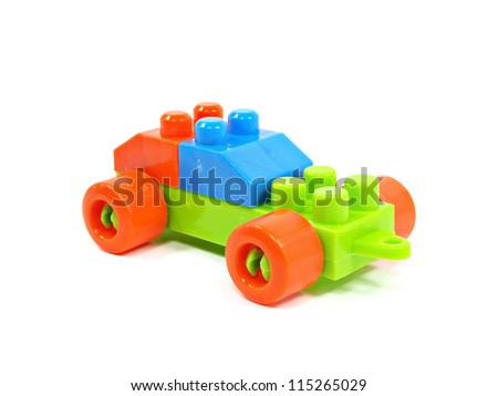 plastic building blocks car on a white background - stock photo