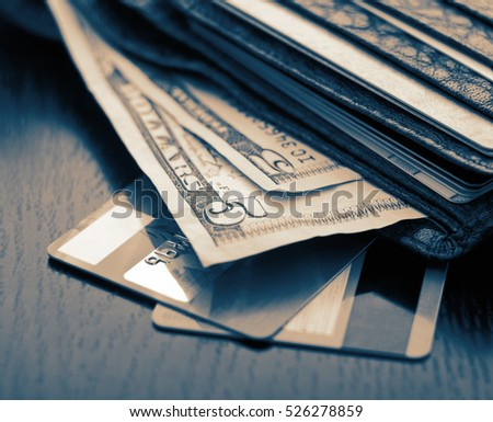 Plastic cards and american dollars in leather wallet