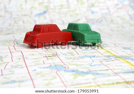 Plastic Cars On Map - stock photo