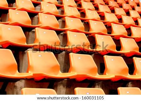 Plastic Chairs in the Stadium  - stock photo