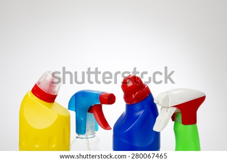 Plastic Cleaning Product Bottles with spot light background - stock photo