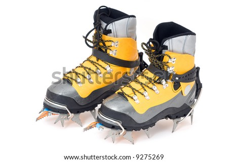 plastic climbing boots with crampons, isolated on white background - stock photo