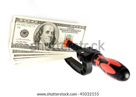 plastic clip with dollars on white - stock photo
