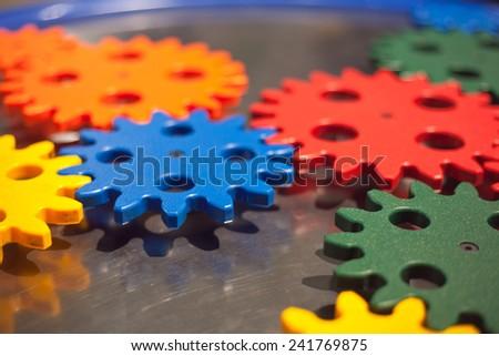 plastic cogwheel working together - stock photo
