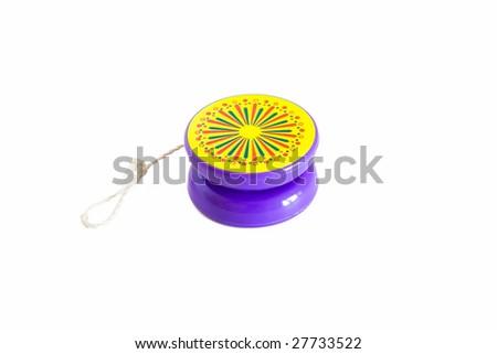 plastic colored yo-yo on white background - stock photo
