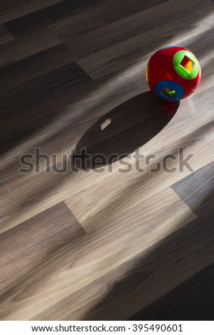 Plastic colorful ball and shadow from the window - stock photo