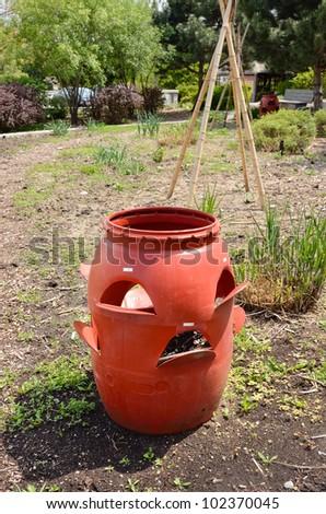 plastic compost bin in garden - stock photo