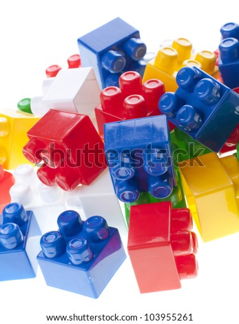 Plastic constructor bricks heap. isolated on white.