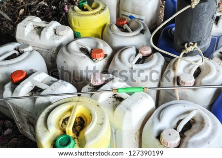 plastic container of insecticide for farmer - stock photo