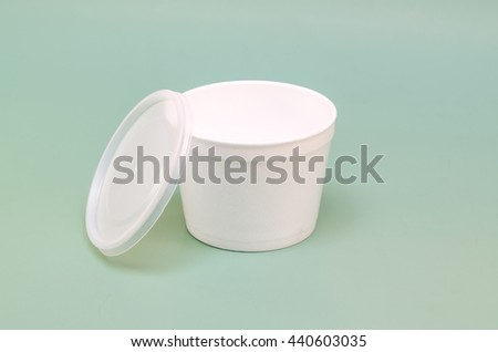 plastic container with a lid Hot food and drinks on a green background - stock photo