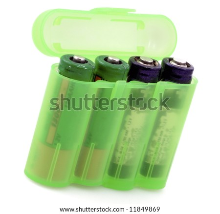 Plastic container with batteries on white background