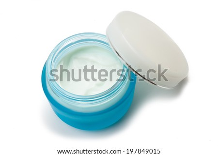 plastic container with cream on a white background.  - stock photo