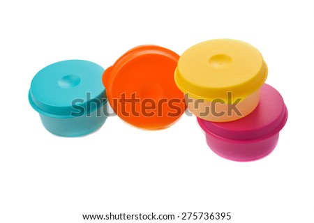 Plastic containers for food with lid ajar isolated on white colorful collage - stock photo