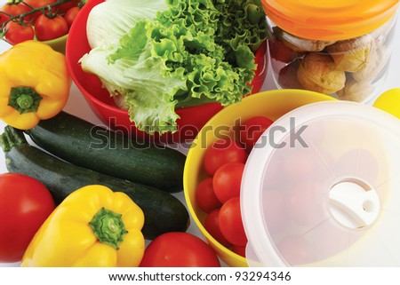 plastic containers for storing food in the fridge - stock photo