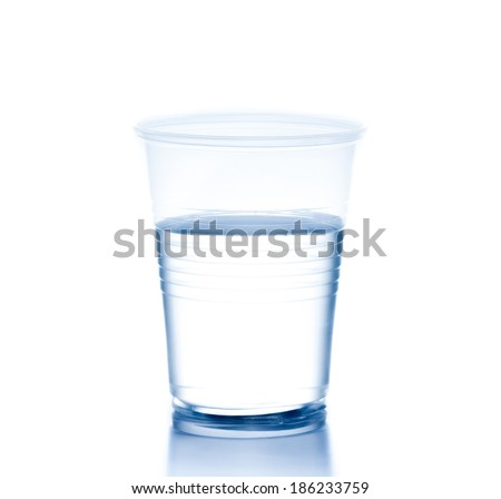 plastic cup with water on white background, concept of nutrition and diet - stock photo