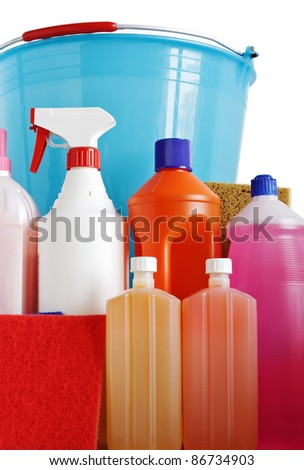 plastic detergent bottles with bucket and sponges isolated on white background
