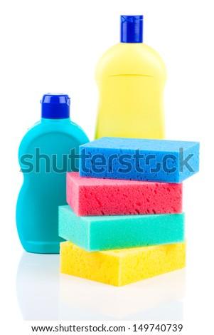 Plastic detergent bottles with sponges - stock photo