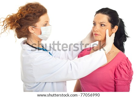 Plastic doctor with protective mask preparing woman for plastic surgery isolated on white background