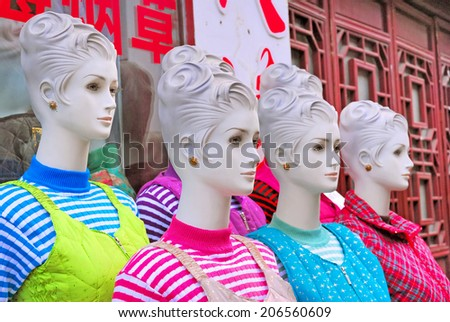 Plastic dummies for dress display at Qibao Shanghai water village. - stock photo