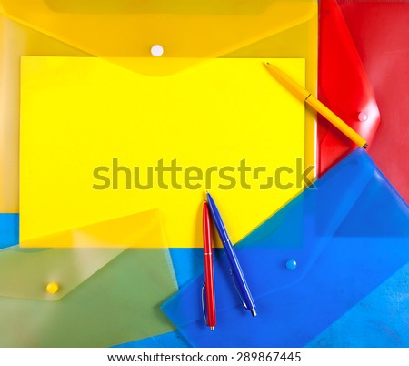 plastic envelopes with colored  pens - stock photo