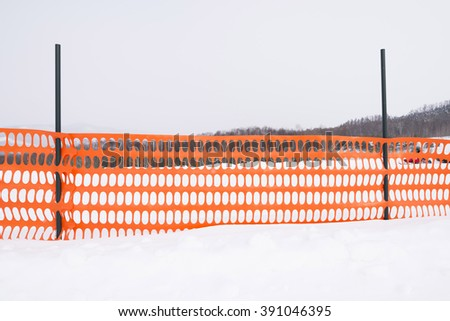 plastic fence and snow  - stock photo