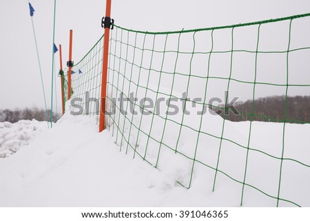 plastic fence and snow with bring eye - stock photo
