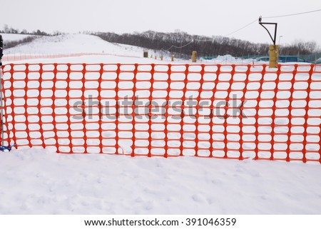 plastic fence and snow with front view  - stock photo