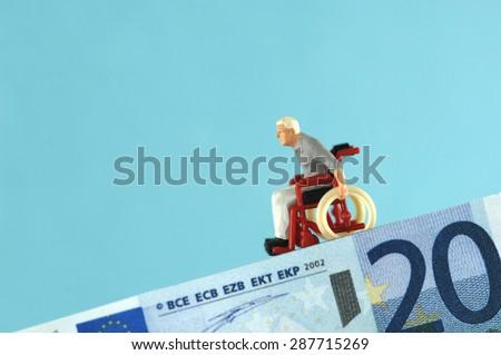 Plastic figurine on banknote - stock photo
