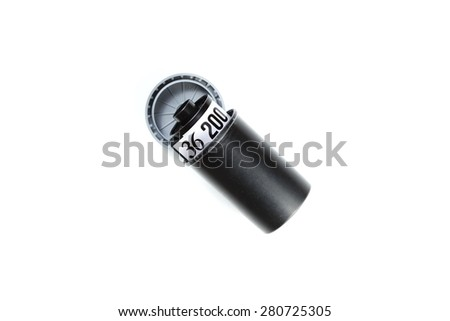 Plastic film cartridge outer box with film cartridge inside represent the film containing and film technology concept related idea. - stock photo