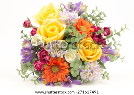 Plastic Floral Bouquet of Different Flowers on White Background - stock photo