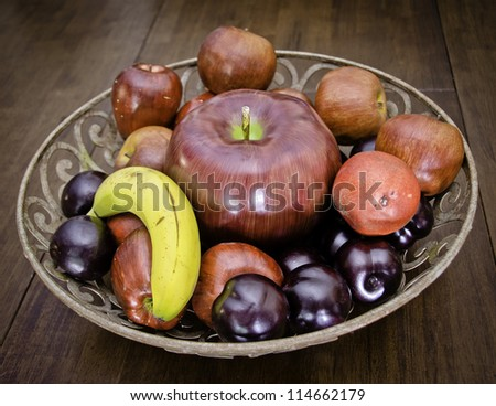 Plastic fruit bowl - stock photo