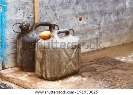 Plastic gas canister on the pick up truck in retro vintage old camera effect.  - stock photo