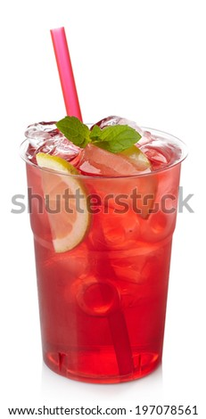 Plastic glass of red cranberry juice and lemon slices isolated on white background - stock photo