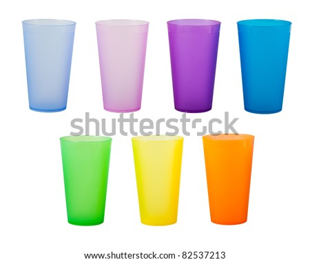Plastic glass of various color isolated on white background - stock photo