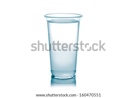 Plastic glass of water isolated on a white background. - stock photo