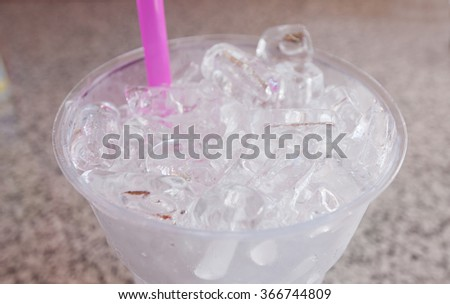 Plastic glass with ice cubes  - stock photo