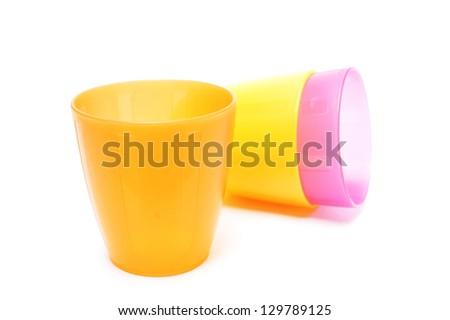plastic glasses on white background - stock photo