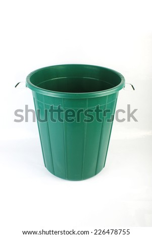 Plastic Green Colored trash can. Garbage Can - stock photo
