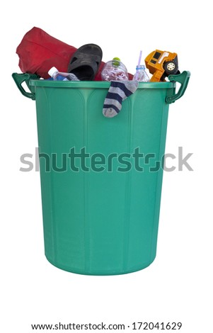 Plastic green recycle bin filled with trash such as sock, toy, plastic drinking water bottle, shoe, bag. - stock photo